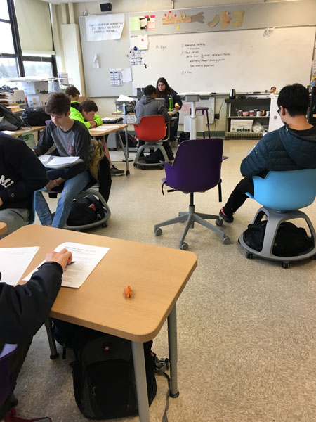 Students in Mrs. Bullinger's class try out the new desks and chairs.