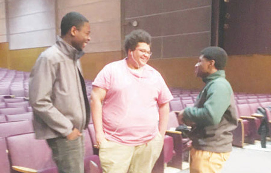 """From right, Treyvon Foster (junior), Shane Collins (junior), and Avery Cosey (senior) discuss plans for """"In The Heights."""""""