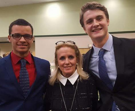 Kane (left) with fellow senior Henry Taylor and U.S. Rep. Debbie Dingell (D-Michigan).