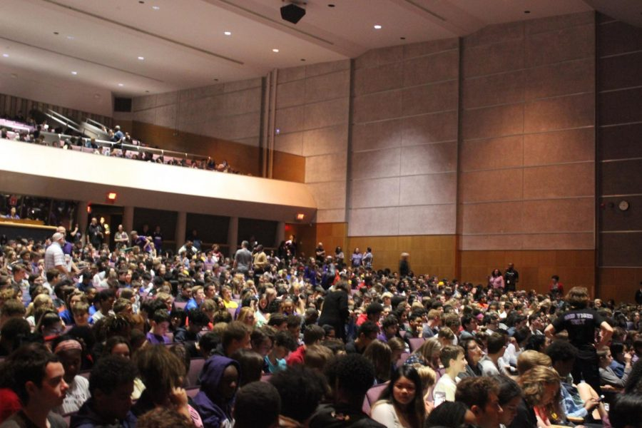 Students wait for the assembly to begin.