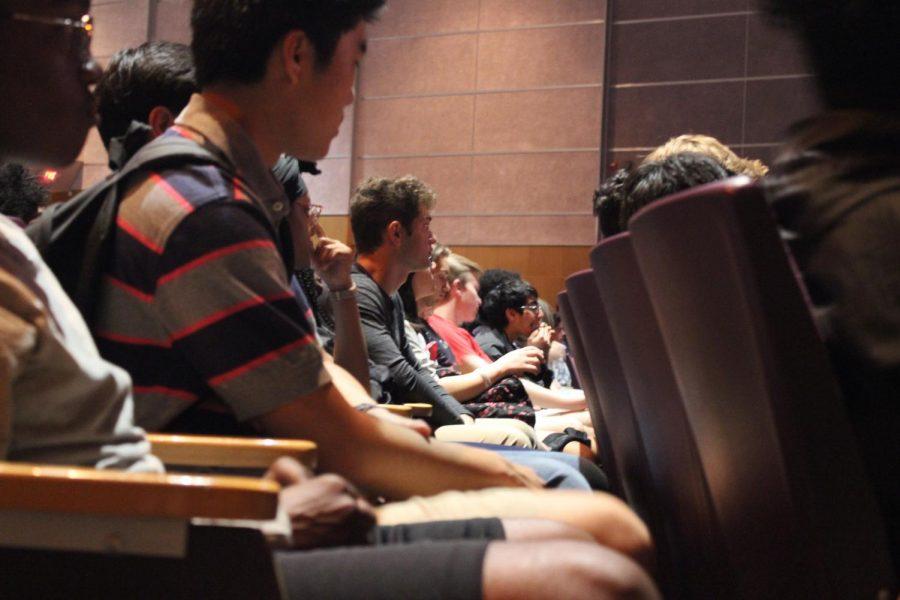Students listen quietly.