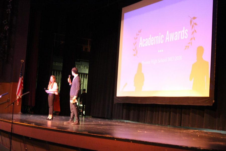 The announcing of the academic awards begins.