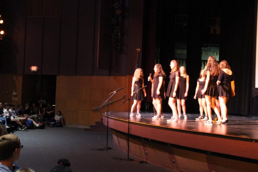One of pioneers a capella groups sings at the assembly.