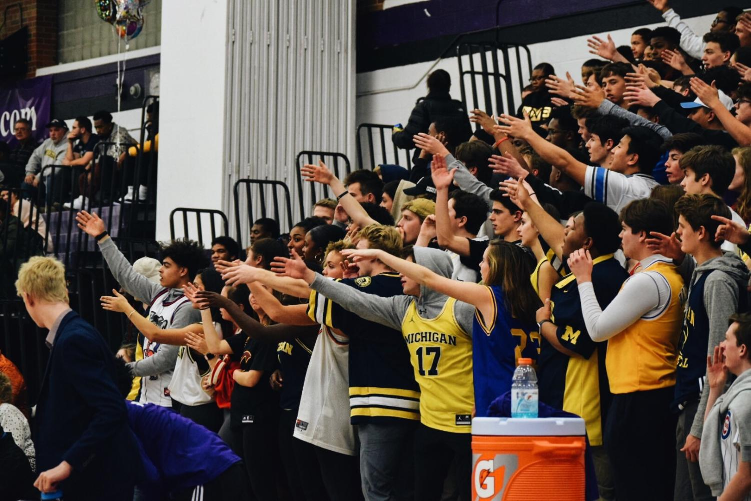 Pioneer+students+in+the+stands+perform+chants+during+the+match+against+the+Huron+River+Rats.