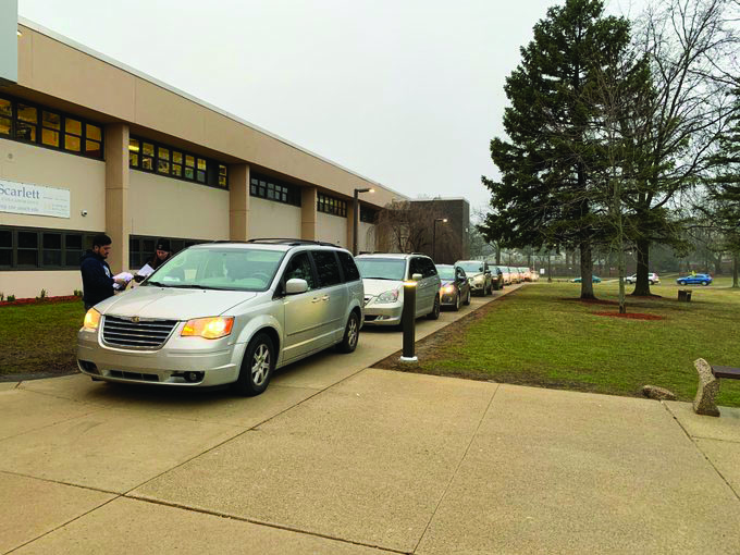 Families line up at Scarlett Middle School to get computers March 19.