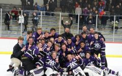The Pioneer varsity hockey team celebrates their victory of the 2020 Jilek Cup.