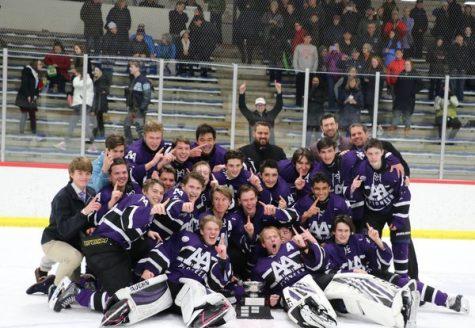 The Pioneer varsity hockey team celebrates their victory of the 2020 Jilek Cup.