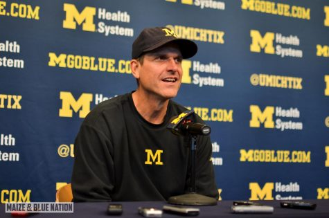 Jim Harbaugh speaks at a press conference (Wikimedia Commons)