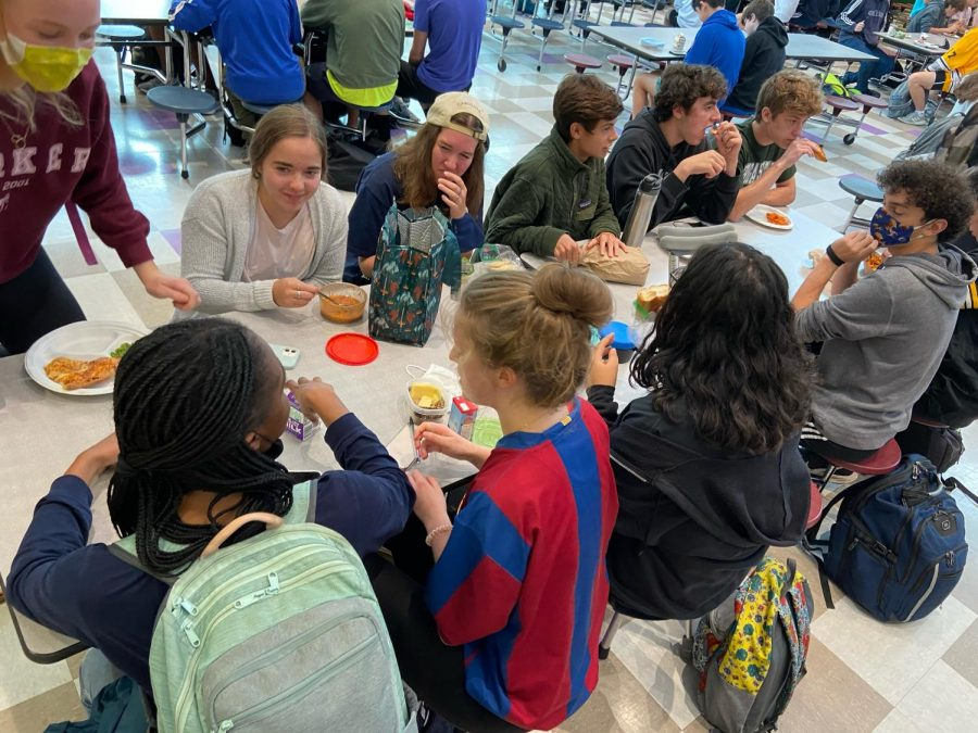 Inside the cafeteria, students crowd around tables with seats just seven inches apart, nowhere near the six feet recommended by the Center for Disease Control.
